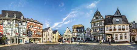 market place: BAD CAMBERG, GERMANY - OCT 11, 2015: people enjoy historic market place in Bad Camberg. In 1000, Emperor Otto III donated the Cagenberg estate to the Burtscheid Monastery.  Cagenberg means Cargos Mountain. Editorial
