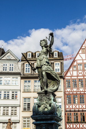 judiciary: Justitia (Lady Justice) sculpture on the Roemerberg square in Frankfurt, built 1887.