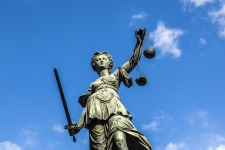 libra: Justitia (Lady Justice) sculpture on the Roemerberg square in Frankfurt, built 1887.
