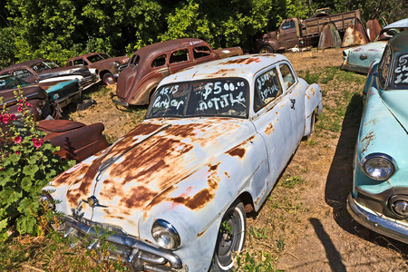 oldie: ORDERVILLE, USA - JULY 17: junk yard with old beautiful oldtimers on the route 89 on July 17, 2008 in Orderville, USA. America is a spot for european classic car hunters.