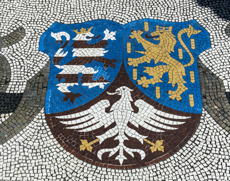 tourisms: WIESBADEN, GERMANY - AUG 8, 2016:  emblem of state of Hesse at Market place in Wiesbaden