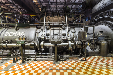 tourisms: VOELKLINGEN, GERMANY - AUG 13, 2016: inside the machine hall for heating at Volklingen Ironworks in Saar, Germany. The plant was in production until 1986.