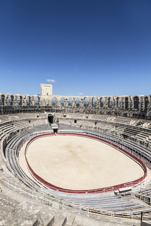 ARLES, FRANCE - AUG 21, 2016: view to famous arena in Arles, France. The old arena still serves as stadium for bull fights. Editorial