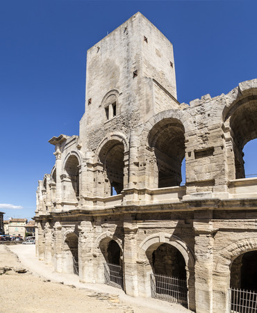 bullfight: view to huge walls  of famous arena in Arles, France