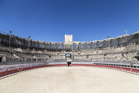 corrida de toros: ARLES, FRANCE - AUG 21, 2016: view to famous arena in Arles, France. The old arena still serves as stadium for bull fights. Editorial