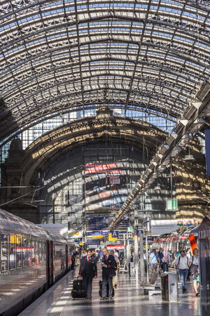 FRANKFURT, GERMANY - AUG 30, 2016: people arrive and depart at Frankfurt train station. The classicistic train station opened in 1899 abd is the biggest in Germany.