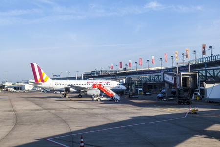 operates: BREMEN, GERMANY - MAY 12, 2016: german wings aircraft operates from Bremen airport and parks for boarding at the gate.