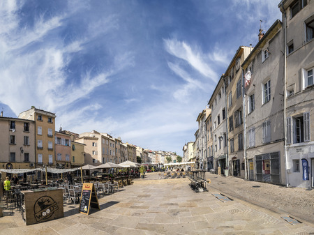 market place: AIX EN PROVENCE, FRANCE - AUG 19, 2016: people enjoy the central market place in Aix en Provence. The market place is surrounded by old buildings from 18th century.