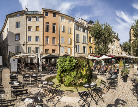 market place: AIX EN PROVENCE, FRANCE - AUG 19, 2016: people enjoy the restaurant at the central market place with fountain covered by moss.