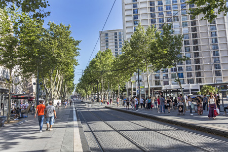 streetcar: MARSEILLE, FRANCE - JULY 9, 2015: people wait for the streetcar in the town of Marseilles, France. Marseille runs a wide net of streetcar connections to cover the local infrastructure. Editorial