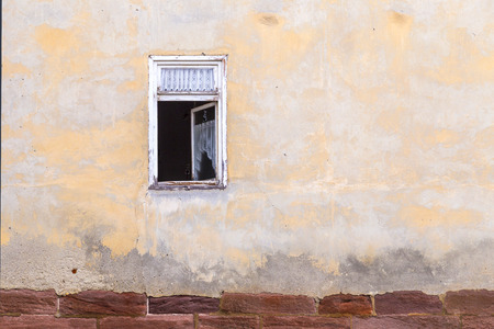 courtain: old open window at an abandoned house