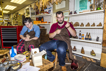vesicle: FRANKFURT, GERMANY - SEP 8, 2016: the shoemaker opens his shop at the annual Bahnhofsviertel party in Frankfurt. He shows the traditional handcraft how to make shoes. Editorial