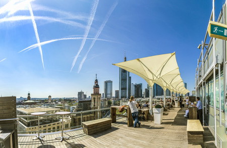 pm: FRANKFURT, GERMANY - SEP 8, 2016: people enjoy the view from the panorama platform to the skyline in Frankfurt, Germany. The Kaufhof platform is open to public from 9.30 am to 9 pm and is free.
