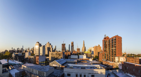 NEW YORK, USA - OCT 20, 2015: skyline of New York in sunset seen from Brooklyn. Brooklyn is the most populous of New York Citys five boroughs, with a Census-estimated 2,6 Mio people.