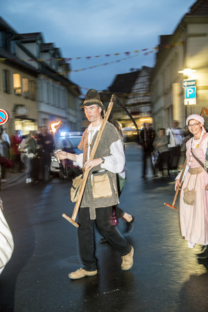 bad times: BAD FRANKENHAUSEN - SEP 17, 2016: people at the farmers procession to remember the farmer revolution in the medieval times in Bad Frankenhausen, Germany.