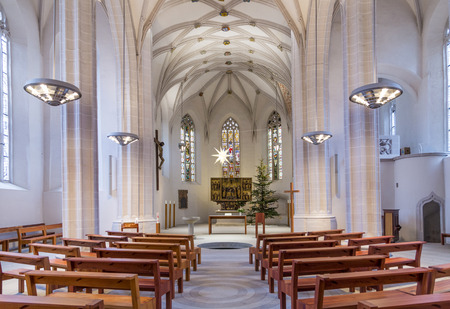 baptismal: EISLEBEN, GERMNANY - JAN 16, 2016: inside famous St. Petri - Pauli church in Eisleben. It is the christening church of Martin Luther, the famous german reformer.