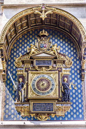 henri: PARIS, FRANCE - JUNE 9, 2015: horloge at the city palace in Paris. The clock was constructed by Henri de Vic in 1370.