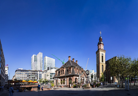 paveway: FRANKFURT, GERMANY - SEP 29, 2016: people enjoy the sunny day  in Frankfurt, Germany in cafe Hauptwache. The baroque building Hauptwache was built in 1730 as a police station and serves nowadays as a cafe. Editorial