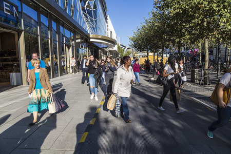 paveway: FRANKFURT, GERMANY - SEP 29, 2016: people walk along the Zeil in Midday in Frankfurt, Germany. Since the 19th century it is of the most famous and busiest shopping streets in Germany.