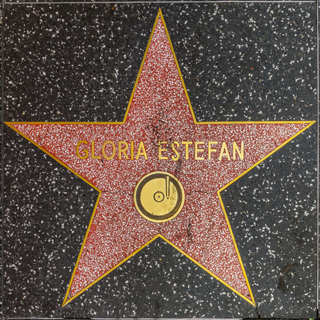 gloria: HOLLYWOOD - JUNE 24, 2012: Gloria Estefans star on Hollywood Walk of Fame in Hollywood, California. This star is located on Hollywood Blvd. and is one of 2400 celebrity stars.