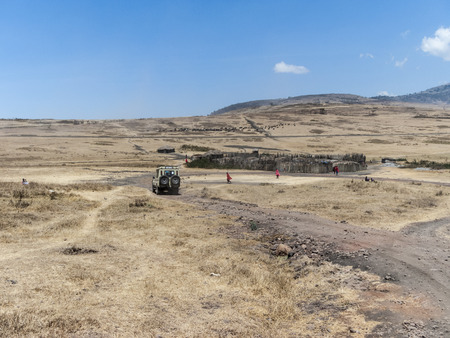cattle guard: NGORONGORO, TANZANIA - AUG 20, 2016: guards of the Ngorongoro national park visit small village of local people in the park area.