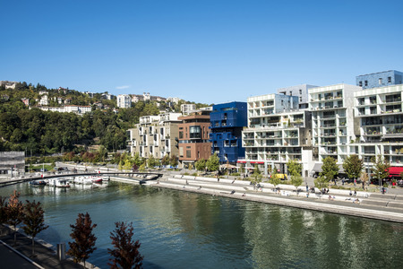 confluence: LYON, FRANCE - OCT 4, 2016: famous Confluence District with people in Lyon, France with river. The architecture is famous for modern style.