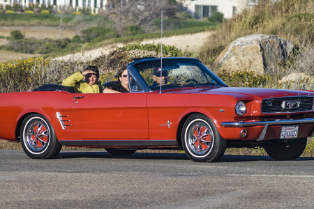 PEBBLE BEACH, USA - JULY 27, 2008: people in vintage cars at  Pebble Beach Concours dElegance. The Pebble Beach Concours d'Elegance began in 1950 when spectators came to see a display of 30 cars in the Del Monte Forest. Editorial