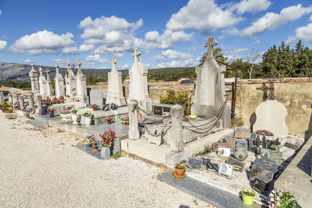 POURRIERES, FRANCE - OCT 22, 2016: old graves at the cemetery. The small old cemetery of Pourrieres is classified as historical monument.