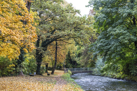 indian creek: beautiful river Wuerm with green trees in Munich in autumn color Stock Photo