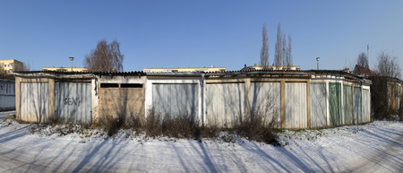 garage doors: old garage doors in a row in the GDR, former socialistic Germany Stock Photo