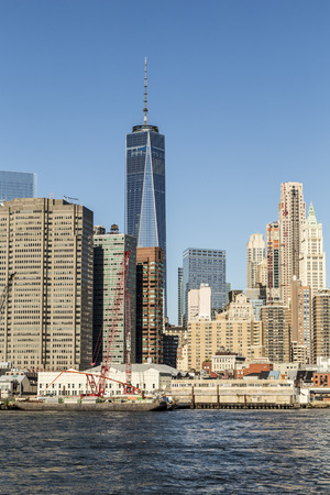 NEW YORK, USA - OCT 23, 2015: view to new skyscraper one World trade center from Brooklyn. The one world trade center is 541 m high. Editorial