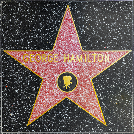 LOS ANGELES, USA - JUNE 26, 2012: George Hamiltons star on Hollywood Walk of Fame   in Hollywood, California. This star is located on Hollywood Blvd. and is one of 2400 celebrity stars. Editorial