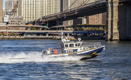 NEW YORK, USA - OCT 23, 2015: New York Police Department controls with the speed boat Detective Robert Parker the river Hudson in New York, USA.