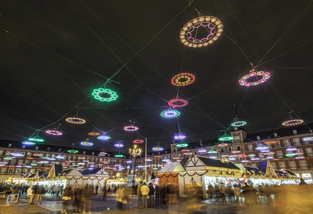 illumination in Madrids Christmas market at the Plaza major Editorial