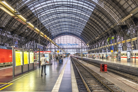 FRANKFURT, GERMANY - AUG 31, 2016: people arrive and depart at Frankfurt train station. The classicistic train station opened in 1899 and is the biggest in Germany. Publikacyjne