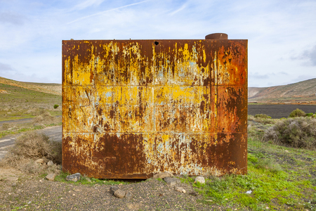 rust red: rusty grunge metal background of an old watertank Stock Photo