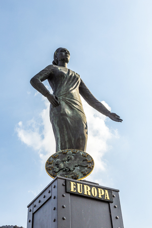 statue of Europa at the Brooks Bridge of Hamburg under blue sky