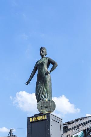 statue of Hammonia at the Brooks Bridge. Hammonia is the Medieval Latin female personification of Hamburg.