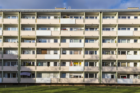 public welfare: facade with balconys of a social housing complex in Munich, Germany Stock Photo