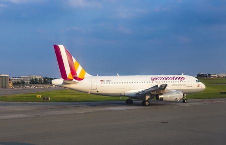 airbus: HAMBURG, GERMANY - JULY 17, 2014: Airbus A319 from the german airline Germanwings taxiing at Hamburg Airport.