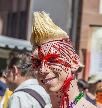 FRANKFURT, GERMANY - JULY 19, 2014: Christopher Street Day in Frankfurt, Germany. Crowd of people, gays, lesbian and bisexuals, participate in the parade celebrating the Christopher street day. Editorial