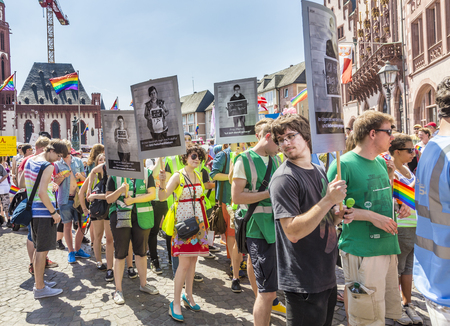 bisexuals: FRANKFURT, GERMANY - JULY 19, 2014: Christopher Street Day in Frankfurt, Germany. Crowd of people Participate in the parade celebrates gays, lesbians and bisexuals.