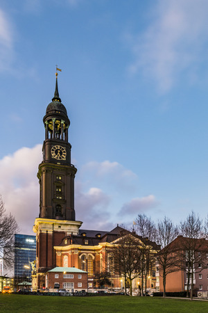 evening view at Michelwiese with St. Michaelis in evening light in Hamburg Stock Photo