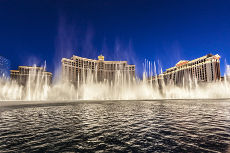 bellagio fountains: LAS VEGAS, USA - JUNE 15, 2012: Las Vegas Bellagio Hotel Casino, featured with its world famous fountain show, at night with fountains in Las Vegas, Nevada. Editorial