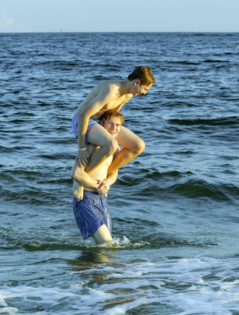 trustful: boys enjoy the beautiful beach in late afternoon  at Dauphin Islands
