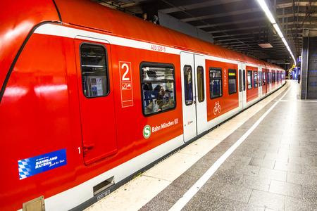 MUNICH, GERMANY - DEC 24, 2014: A commuter train waits at the Munich Railway Station Karlsplatz. The train is part of Deutsche Bahns fleet, the German national railway company. Editorial