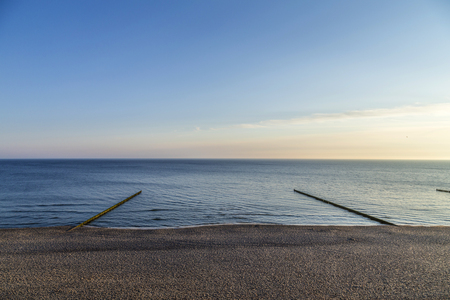 breakers: beach landscape with wooden wave breakers at Koserow on Usedom Island