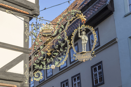 forger: QUEDLINBURG, GERMANY - JAN 8, 2016: scenic old sign zum Roland at half timbered house symbolizes a Restaurant. Editorial