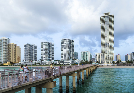 SUNNY ISLES BEACH, USA - AUG 17, 2014: people catch fishes at  the pier in Sunny Isles Beach, USA. In 1936, Milwaukee malt magnate Kurtis built the Sunny Isles pier. Editorial
