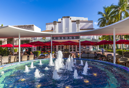 MIAMI, USA - AUG 1, 2013: people enjoy restaurant at famous Colony Art Deco Theater renovated for 6,5 Million USD and open for public again   in Miami, USA. Build in 1934 in art deco style to entertain the visitors.